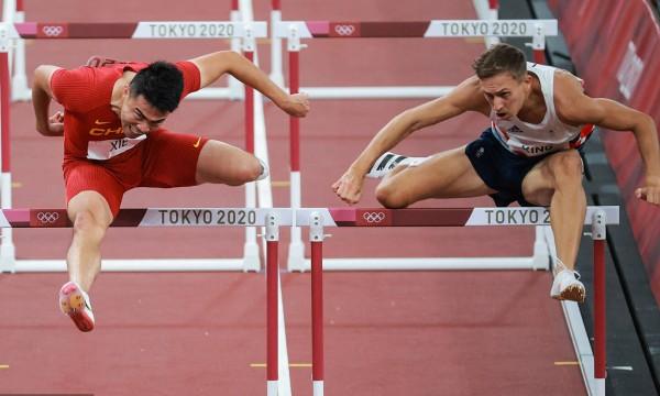 奥运男子110米栏预赛 谢文骏13秒51晋级半决赛